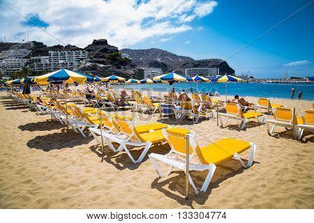PUERTO RICO, GRAN CANARIA, SPAIN_MAY 20, 2016: Public beach of Puerto Rico on May 20, 2016 at Gran Canaria. Spain.