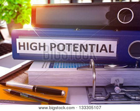 Blue Ring Binder with Inscription High Potential on Background of Working Table with Office Supplies and Laptop. High Potential Business Concept on Blurred Background. 3D Render.