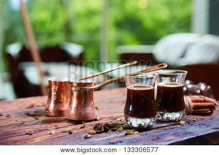Traditional Arabic coffee. Traditional Arabic coffee. Two copper pots and two glass cups