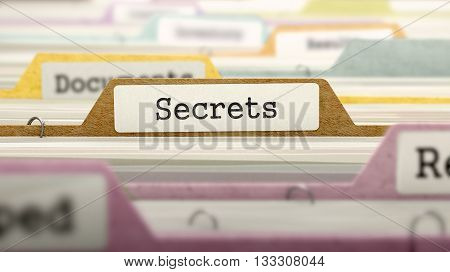 Secrets Concept on File Label in Multicolor Card Index. Closeup View. Selective Focus. 3D Render.