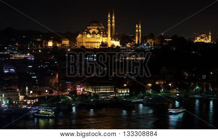 Istanbul skyline from Galata bridge by night, with Suleymaniye mosque, Istanbul Turkey