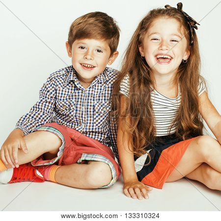little cute boy and girl on white background, happy family smiling twins, lifestyle people concept