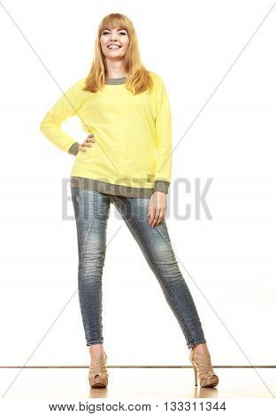 Fashion. Full body blonde fashionable woman jeans pants yellow blouse. Female model posing isolated studio shot