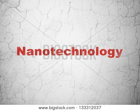 Science concept: Red Nanotechnology on textured concrete wall background