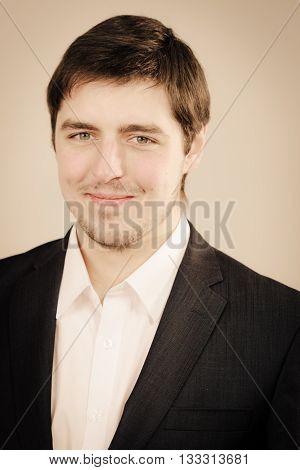 Chic clothing for men. Portrait of elegant man. Young male wearing white official shirt and black classic suit.