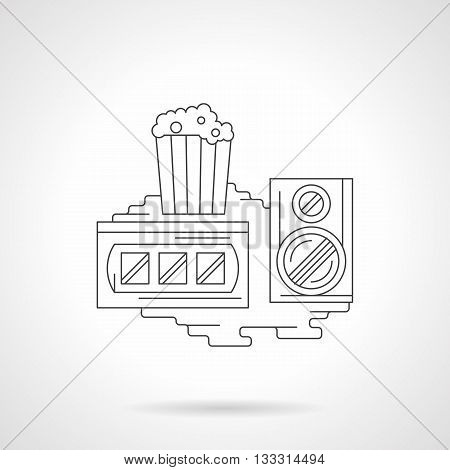 Popcorn in disposable cup, audio speaker and film strip. Retro video viewing. Movie time sign. Single detailed flat line vector icon. Web design element.