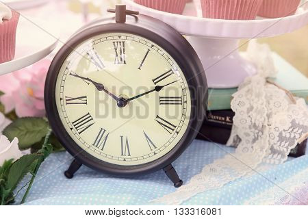 A clock Alice in wonderland Mad Hatters tea party toning