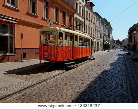 Bydgoszcz, Poland - June 05, 2016: The historic tram above the alley in the old city of Bydgoszcz, as a Tourist Information Centre.