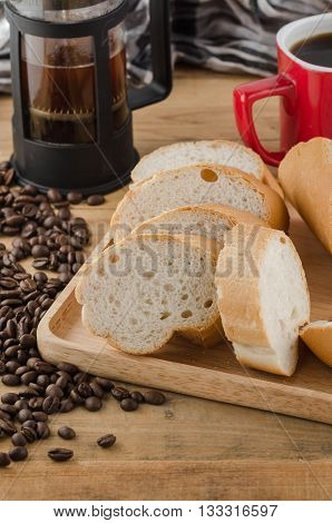 French Bread, Baguette With Coffee Beans On Wooden Background