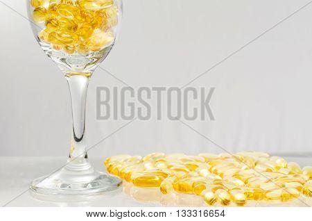 Close Up Fish Oil In A Wine Glass