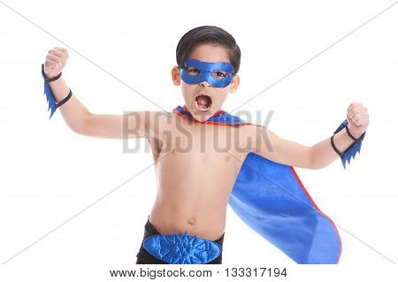 Super Fun.  Adorable mixed race boy dressed as a superhero isolated on white.