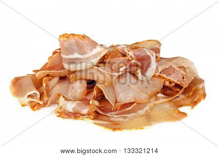 Pancetta, sliced, isolated on white.  Delicious traditional spicy cured pork.