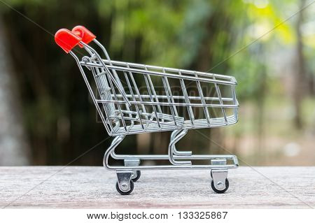 Close up model shopping trolley on the wood