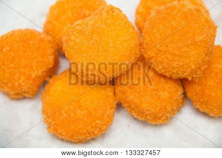 Some fresh chicken nuggets on a white background