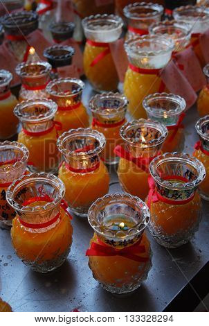 Candle glasses to worship god in a Chinese shrine.