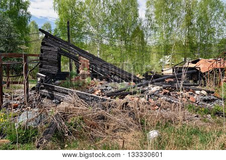 Remains of burned down house in the village