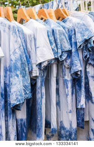 Traditional thai clothes of natural indigo dyeing extracted from plants hanging at garden; folk wisdom in Thailand