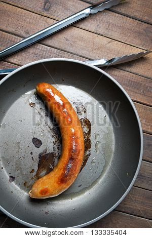 fried organic grilled sausage on the skillet frying pan