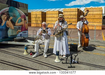 Napier New Zealand - November 19 2014: The Twin City Stompers Art Deco Dixieland Jazz Band greets visitors at the port of the seaside town of Napier on the North Island New Zealand.