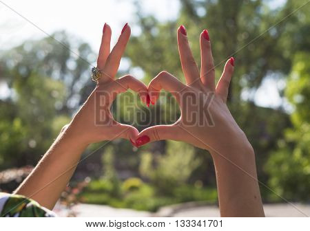 Young couple in love holding hands on the sunset during summer evening.