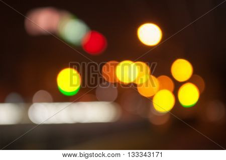 Night city, blurred view of the night city. Night lights with bokeh effect, blurred background. Blurred street lights, urban abstract background.