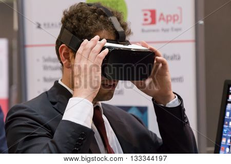 Man Trying Virtual Reality Headset At Technology Hub In Milan, Italy