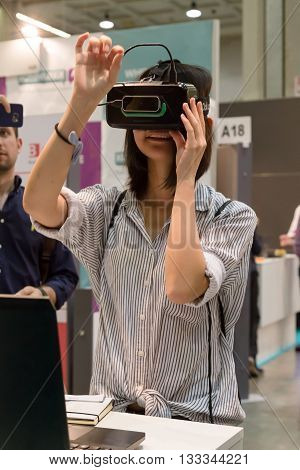 Woman Trying Virtual Reality Headset At Technology Hub In Milan, Italy
