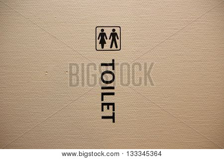 Unisex Toilet Sign on White Structured Wall