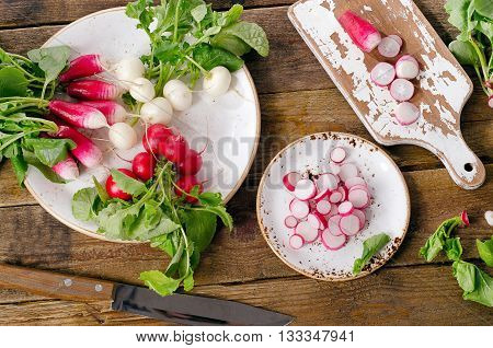 Bundle Of Organic Radishes On A Table.