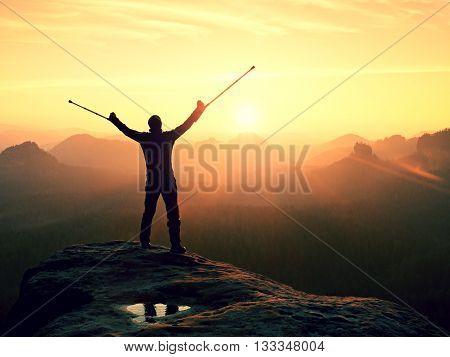 Man With Broken Leg And Medicine Crutch.  Hiker With Leg In Immobilizer Achieve Peak