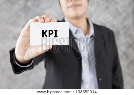 Businessman Presenting Business Card With Word Kpi