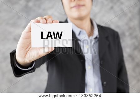 Businessman Presenting Business Card With Word Law