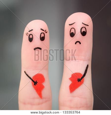 Finger art of couple. Couple holding broken heart.
