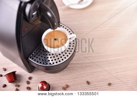 Espresso Machine Making Coffee On Wood Table Elevated View