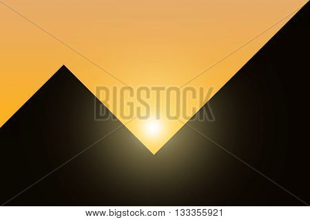 The contours of the Egyptian pyramids against the setting sun