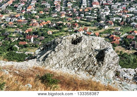 Rural landscape and village from the hill Zobor above the Nitra city Slovak republic. Rock and houses. Outdoor scene. Tourism theme. Red roofs.
