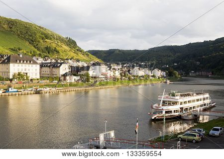 COCHEM, GERMANY - SEPTEMBER 15, 2010: Cochem cityscape with Mosell river in a sunny evening. Cochem is a small town with just over 5000 inhabitants in the Rhineland-Palatinate state in Germany.