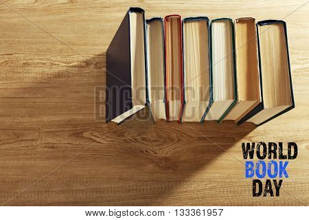 Old books on wooden table, top view. World Book Day poster