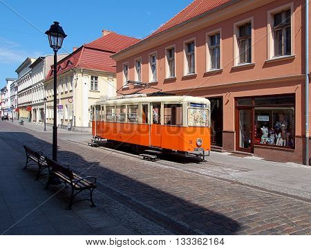 Bydgoszcz, Poland - June 05, 2016 The historic tram above the alley in the old city of Bydgoszcz, as a Tourist Information Centre.
