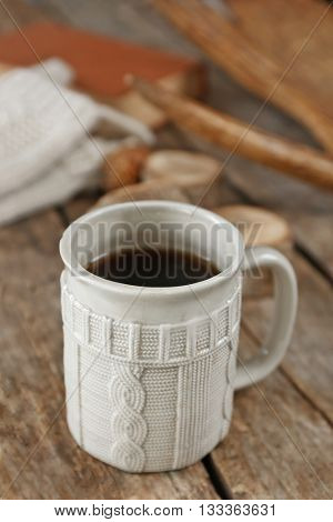 Beautiful winter composition with cup of hot drink