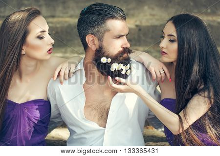Bearded Man And Women On Stairs