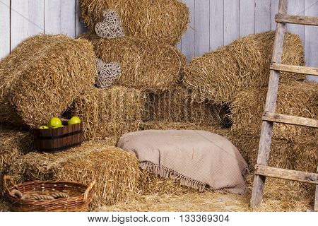the straw bales stacked in a shed