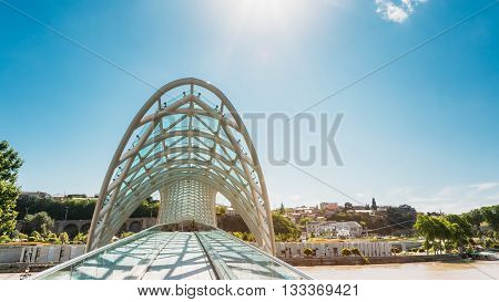 The Bridge of Peace is a bow-shaped pedestrian bridge over the Kura River in Tbilisi, capital of Georgia. The bridge which stretches 150 metres - 490 ft - over the Kura River was ordered by the City Hall of Tbilisi to create a contemporary design feature