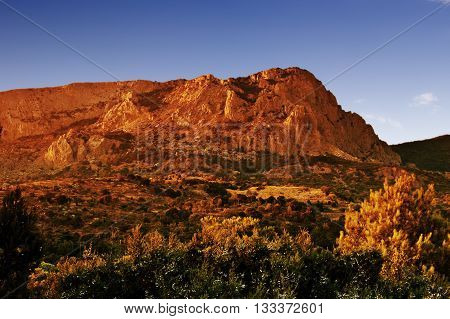 view of a mountain range at sunset