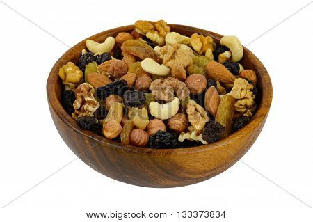 Nuts mix in a wooden plate isolated on white background