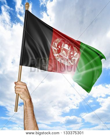 Person's hand holding the Afghan national flag and waving it in the sky, 3D rendering