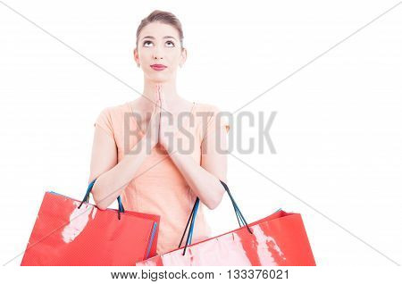Woman Carrying Shopping Bags Praying And Hoping For Something