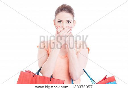 Pretty Woman Holding Shopping Bags Making Mute Gesture