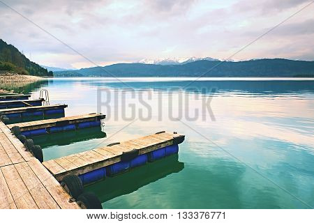 Empty Wooden Mole On  Blue Alps Lake, Wharf For Hired Boats