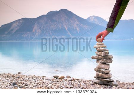 Man Built Pyramid From Pebbles. Balanced Stones Pyramide Memories